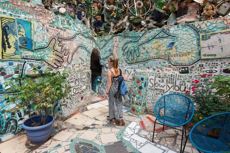 Philadelphia Magic Gardens, rear view of a young woman exploring the mosaics in Philadelphia's Magic Gardens, Philadelphia, Pennsylvania, PA, USA.