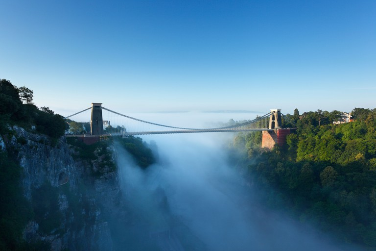 Morning mist in the Avon Gorge at Clifton Suspension Bridge. Bristol. England. UK.