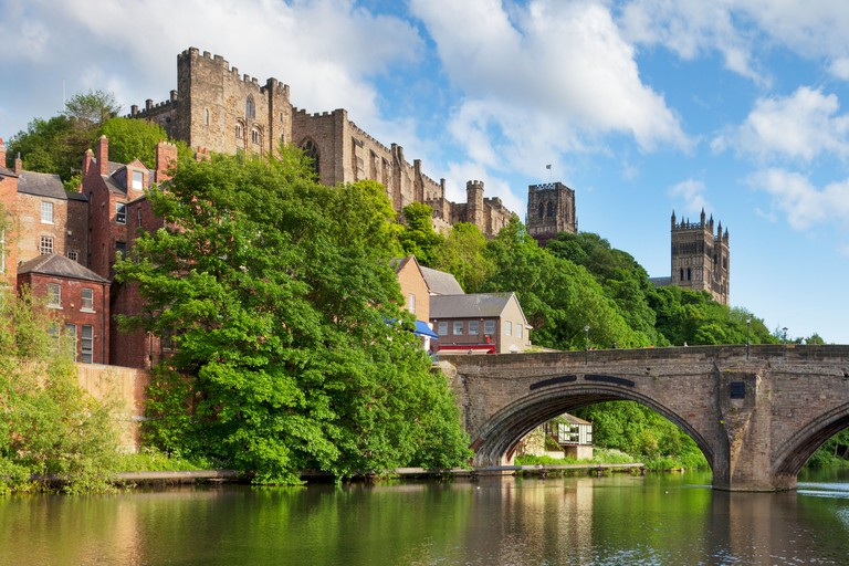Durham Castle and Cathedral on their rock above the city, and Framwellgate Bridge spanning the River Wear