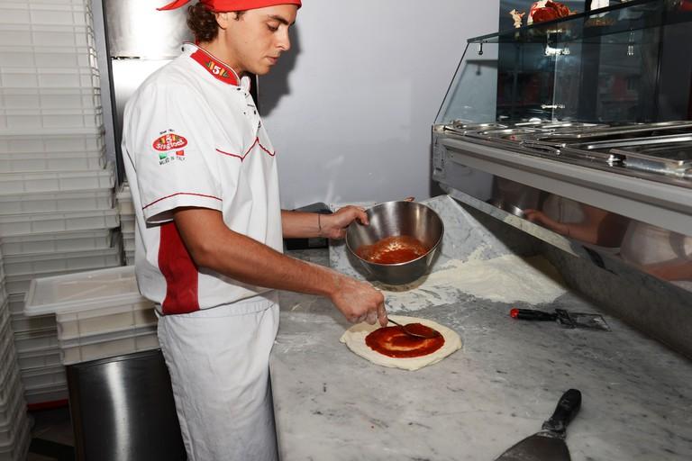 Alessandro Izzo, the pizza chef of pizzeria Palazzo Petrucci in the center of Naples.