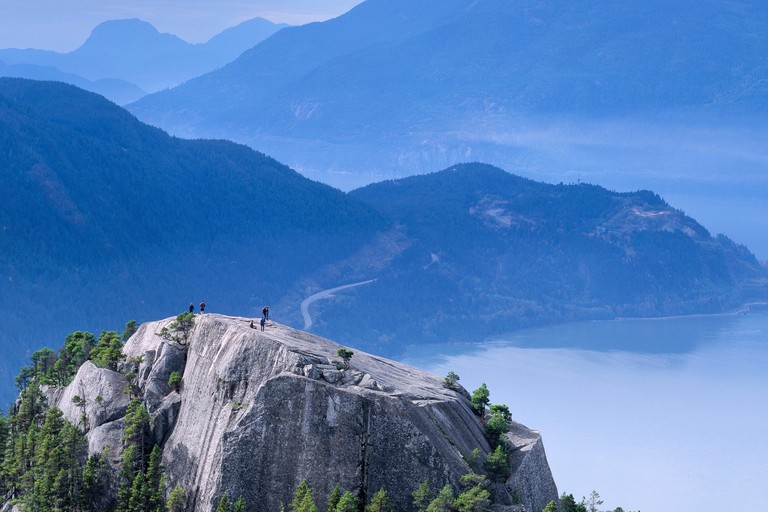Hikers on the first peak of The Chief in Stawamus Chief Provincial Park, Squamish, British Columbia.