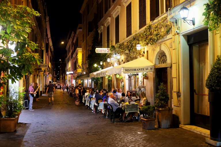 Rome Italy July 2017 - Eating out in one of the many narrow streets in the Tridente district