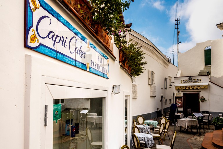Tiled Capri Cakes sign on cafe