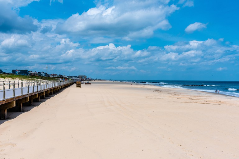 The beach and boardwalk in Spring Lake NJ on a beautiful day in May.