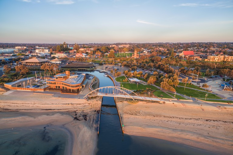 Aerial view of Frankston waterfront at sunset. Frankston yacht club and footbridge over Kananook creek.