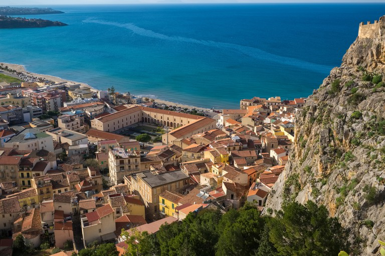 Aerial view of the city and red rooftops of Cefalu, Sicily, Italy, Europe