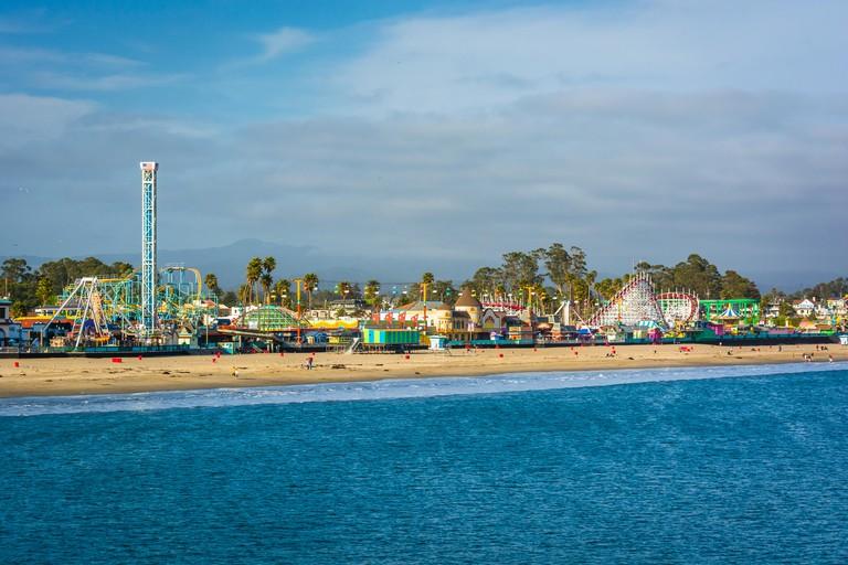 View of the rides on the Santa Cruz Boardwalk and the beach from the Wharf, in Santa Cruz, California.