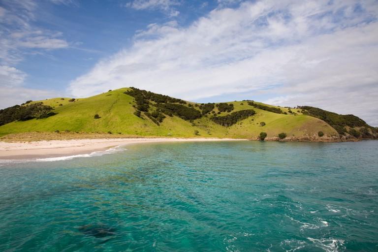 View back to Waewaetorea Island recreational reserve with sandy beach, Bay of Islands, Northland, North Island, New Zealand