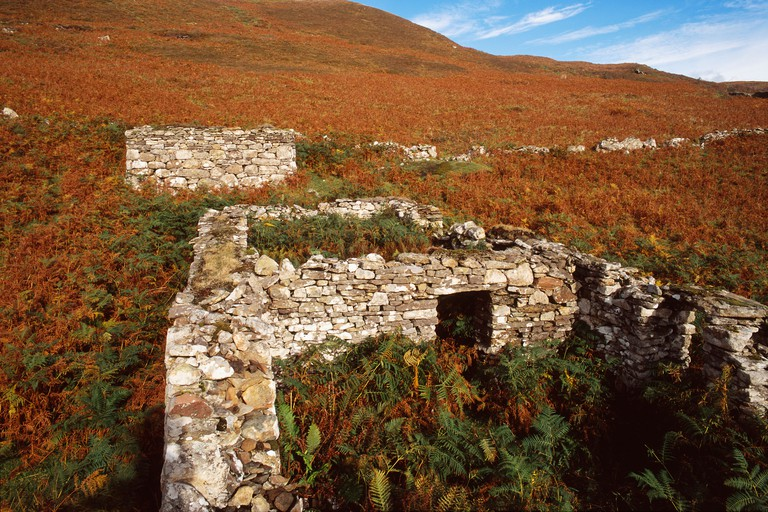 Ruined houses and field-wall at the Clearance village of Boreraig in southern Skye, western Scottish Highlands and Islands. Image shot 2006. Exact date unknown.