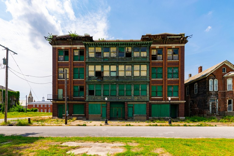Cairo, IL, United States - May 19, 2018: Abandoned and boarded up buildig in Cairo, Illinois.