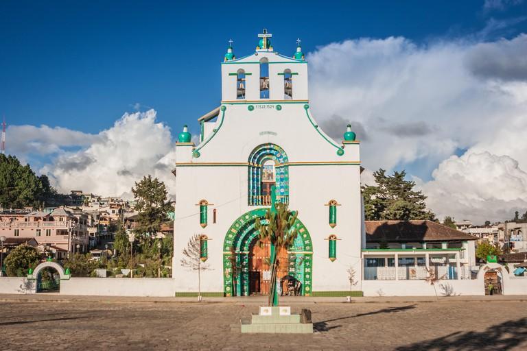 Front view of the San Bautista church in San Juan Chamula market, Chiapas, Mexico.