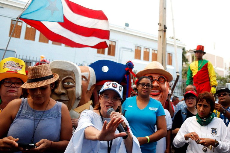 San Juan, Puerto Rico. 17th Jan, 2020. People participate during the procession of the traditional Fiestas de la Calle de San Sebastian, in San Juan, Puerto Rico, 16 January 2019. The fiftieth anniversary of the traditional Fiestas de la Calle de San Seba