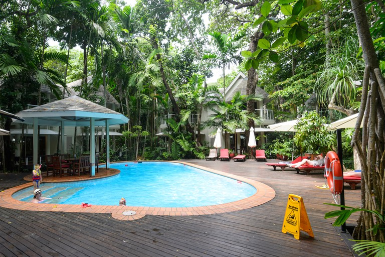 Swimming pool in lush environment at luxury Green Island Resort, Great Barrier Reef, Far North Queensland, QLD, FNQ, GBR, Australia