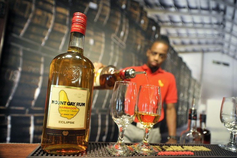 June 12, 2012 - Bridgetown, Barbados, U.S. - An employee pours a tasting inside a replica of a traditional rum shop at the Mount Gay Rum Distillery in Bridgetown, Barbados. Mount Gay Rum is the oldest existing brand of rum in the world. (Credit Image: © J