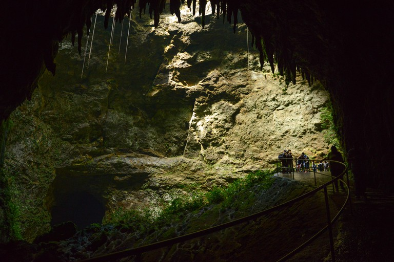 Tourists observing some stalactites at the Camuy River Cave Park. PUERTO RICO - Caribbean Island. US territory.