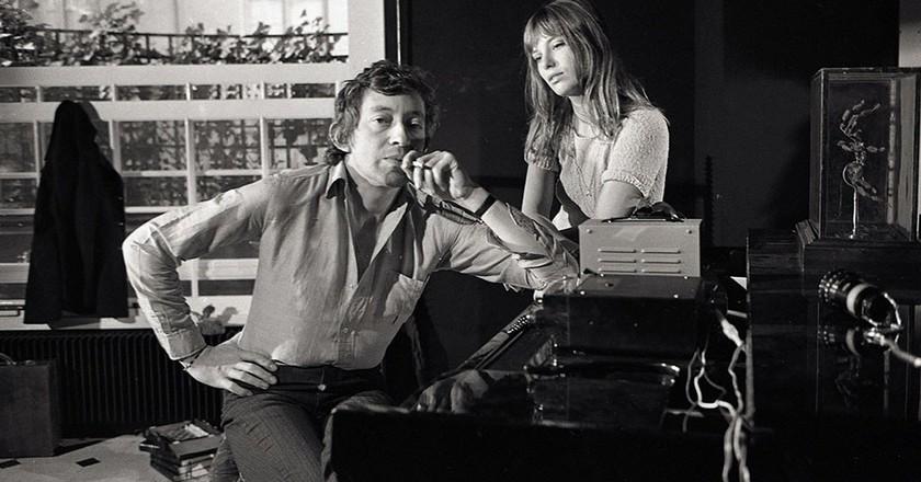 Serge Gainsbourg (1928-1991) and Jane Birkin (1946-) around a piano. Photography by Kelaidites circa 1969 Art - various