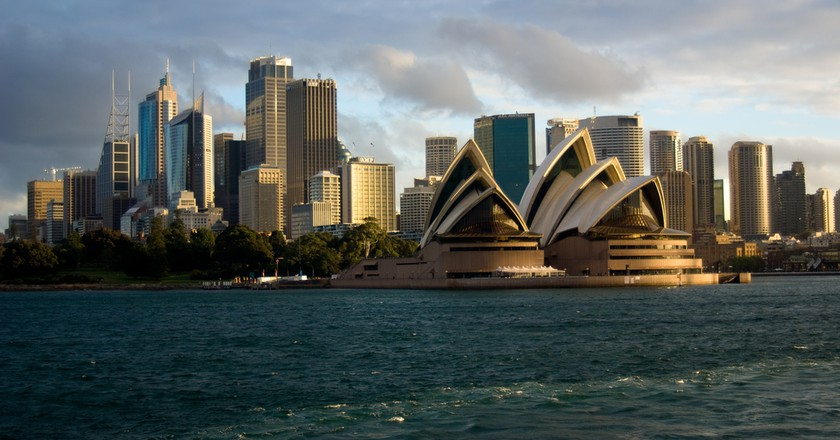 Sydney Opera House with city in background ©Corey Leopold