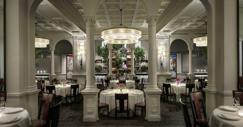 Front view of the main dining room decorated with mixed flowers at Daniel in NY | Courtesy of Daniel, credit: Francesco Tonell