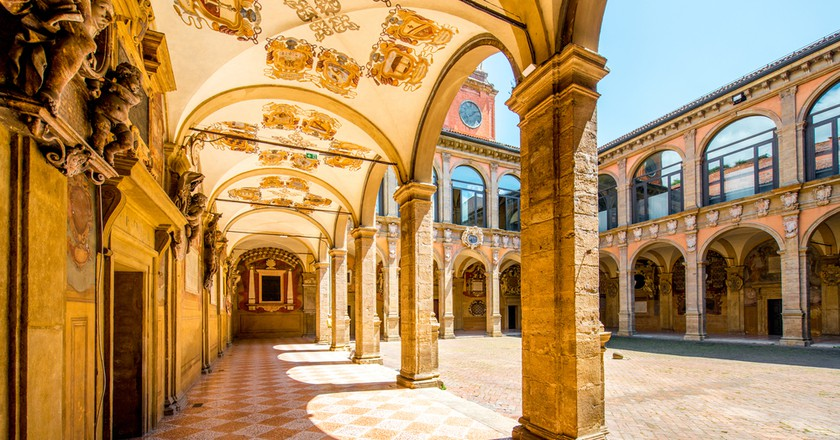 The inner yard of the Archiginnasio of Bologna that houses the Municipal Library and the famous Anatomical Theatre   © RossHelen/Shutterstock