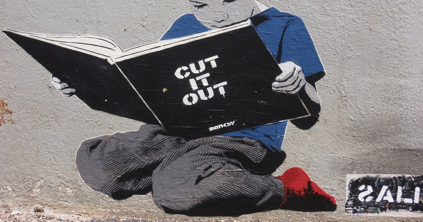 Reading by Bansky, Paris | Jeanne Menj/Flickr