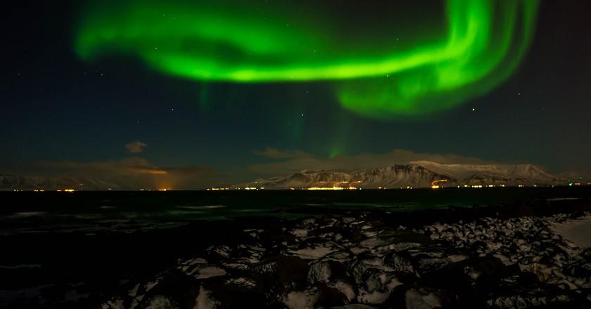 Northern Lights over Reykjavik | © sergejf / Flickr