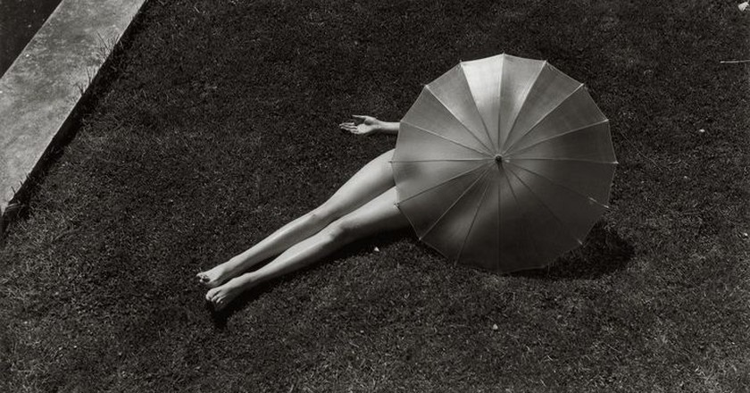 Martin Munkácsi, Nude with Parasol, Harper's Bazaar, 1935 | © Martin Munkácsi Estate, Courtesy of Howard Greenberg Gallery NYC