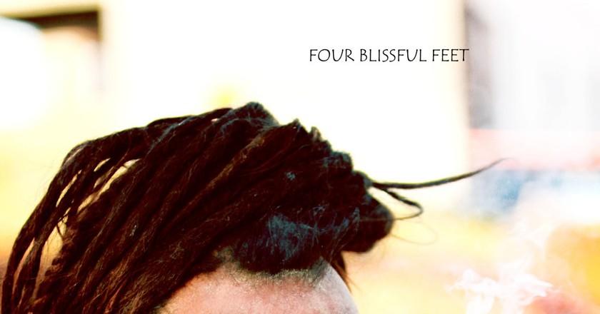 Baba smoking Marijuana using Chillum | © Four Blissful Feet