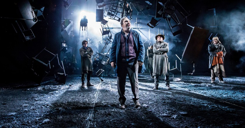 A scene from As You Like It, foreground Paul Chahidi (Jaques) | © Johan Persson