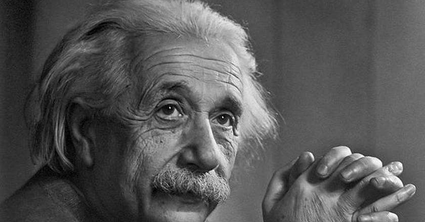 Einstein's Gravity: Black Holes, Dark Matter and Gravitational Lensing