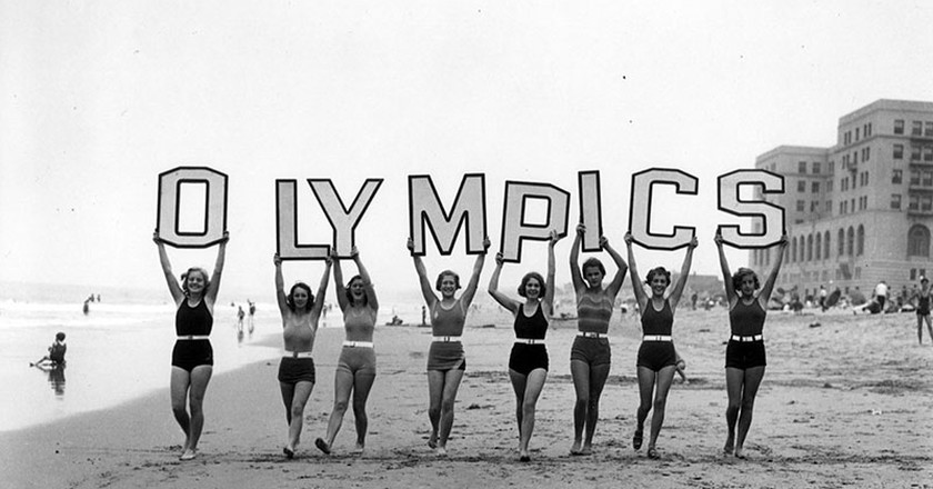 To promote the 1932 Olympic Games in Los Angeles, women spell out O-L-Y-M-P-I-C-S on the beach not far from the Waverly Club, right, in Santa Monica. | Courtesy of the Los Angeles Public Library