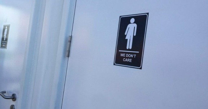 'We Don't Care' signage on bathroom at CNE 2016.