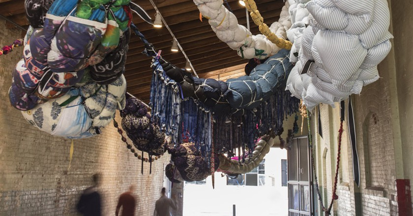 Installation view, 'Revolution in the Making: Abstract Sculpture by Women, 1947 – 2016', Hauser Wirth & Schimmel, 2016; Shinique Smith: 'Forgiving Strands' 2015 – 2016 | Photo by Brian Forrect, courtesy of the artist and Hauser & Wirth.