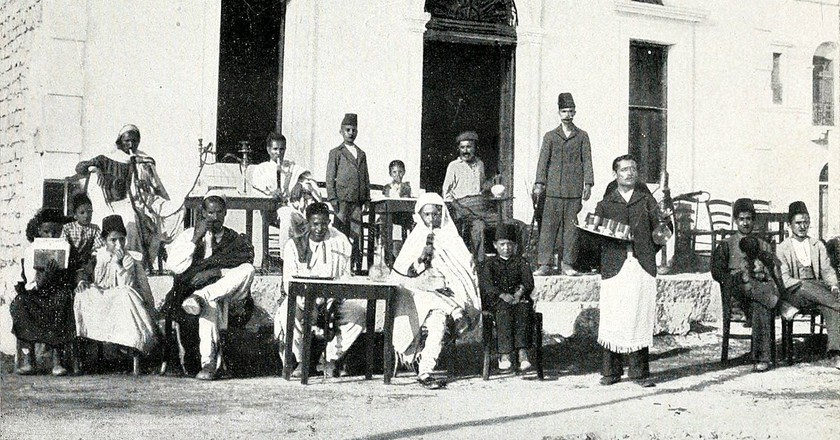 """Men only at an Ottoman coffee house in Libya. 