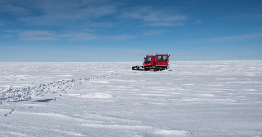 A member of the Concordia team walks across the Antarctica Ice| © Beth Healey