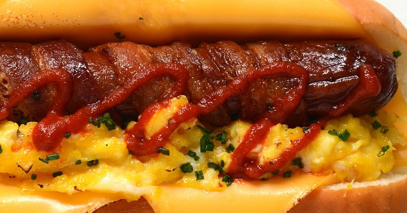 Breakfast Hot Dog bacon wrapped scrambled eggs american cheese Sriracha chives Hawaiian bun | © Personal Creations/Flickr