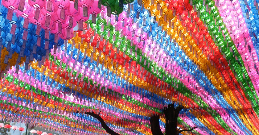 Lanterns hang at a temple in Seoul to celebrate the birth of Buddha | © GohRo / Flickr