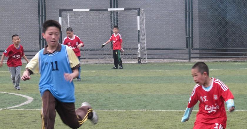 Kids playing soccer in Beijing | © Flickr/Ivan Walsh