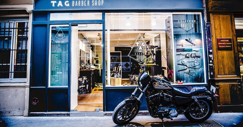 Shopfront and motorbike │ Courtesy of TAG Barbershop