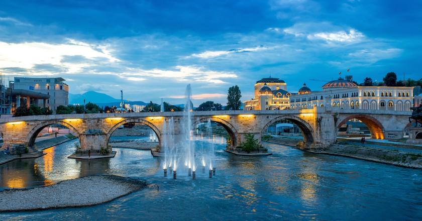 Stone bridge from Oko bridge in Skopje in the evening ©RossHelen / Shutterstock