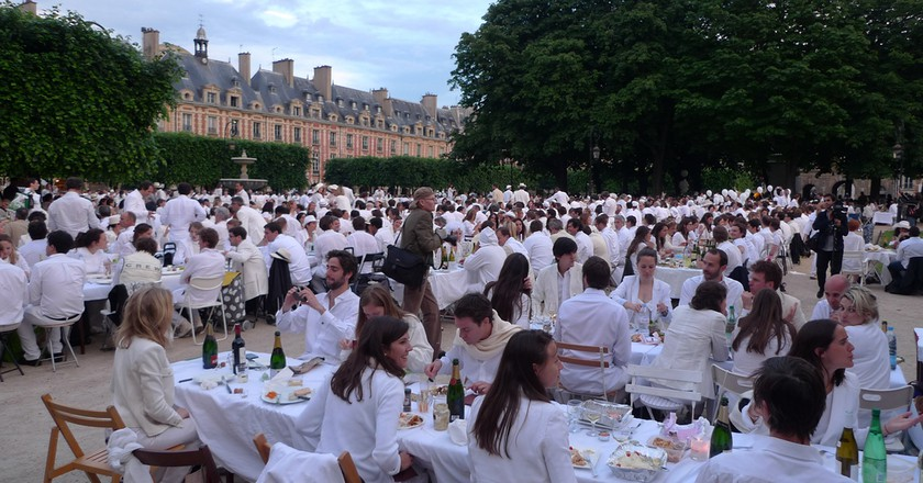 "White dinners are a chic affair where everyone brings a picnic and tables and has a ""pop up"" dinner 