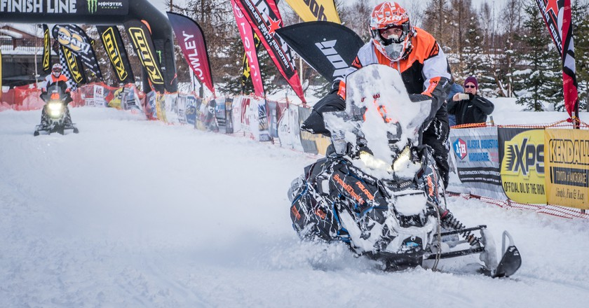 Racers cruise through the finish line at the 2017 Iron Dog in Fairbanks, Alaska | Roger Clifford, Official Iron Dog Photographer