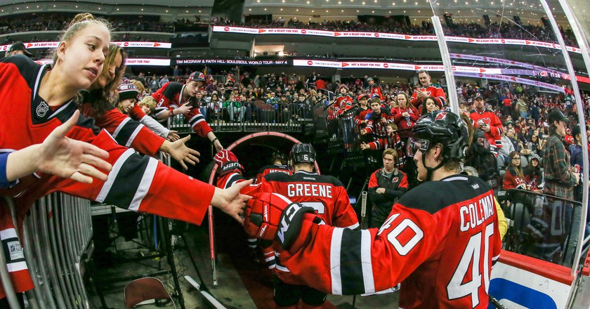 Devils' Blake Coleman (40) and Andy Greene (6) acknowledge fans as they come off the ice | © Mike Langish / CSM / REX / Shutterstock