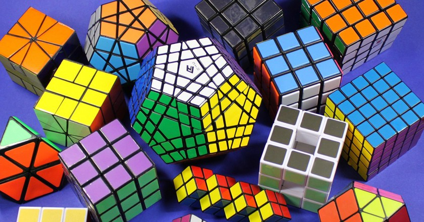 """<a href=""""https://www.flickr.com/photos/scarygami/4214513596/sizes/l"""">Rubik's Cube Collection   © Gerwin Sturm / Flickr </a>"""
