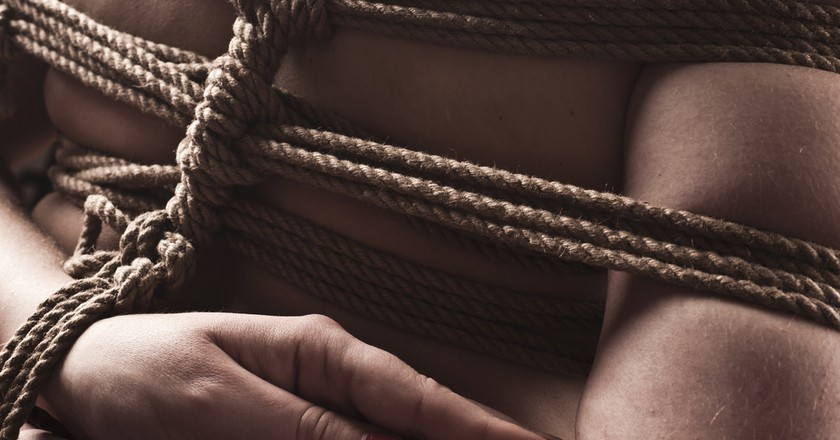 Young submissive woman in japanese bondage   © UVgreen/Shutterstock