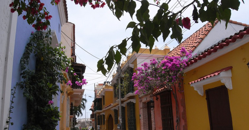 "Cartagena Colombia's Old City | © <a href=""https://www.flickr.com/photos/moonrat/29420689962/in/photolist-LPNJ8d-L3sCsM-LtfPZL-KMYvLw-LK4DHe-LiDtES-LHx9A2-LSt3Nq-L3sB1t-LZtf4i-LNqGfV-KXAdjS-PhUwNc-L3st9M-KXNfS2-LzbHzo-L3sbYv-LSsNyJ-LXMfg9-L3sah4-LUL9Zg-LG5EBA-LzvB2C-KLENq4-L4xNXQ-LZsAQR-M1Nu2V-LG5CLm-KLEBBv-P7QyJa-LXMgi9-LWpLeW-LVvLFF-LTwNtD-KVYMde-LKpM2i-LKR2Ba-LSuomv-KYuRLv-KYuQqp-LVtYAr-LtXyuq-LPSNEA-LUGqHi-LQuwpC-LTwUie-LPSFzU-LQv2CY-LSVQE2-KVKiNS""> Natalia Wilson / Flickr </a>"