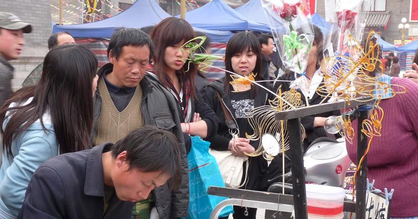 """<a href""""https://www.flickr.com/photos/santangelo-jon/4527606399""""> Tianjin People © Jon Santangelo/Flickr</a>"""