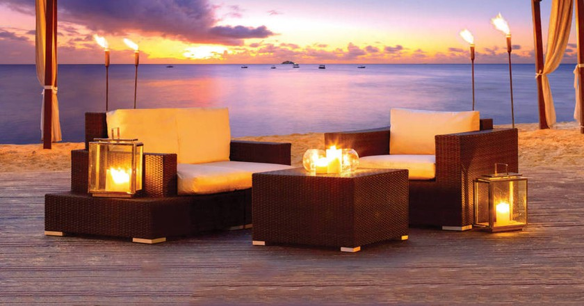 Candlelit Beachside Tables |Courtesy of The House by Elegant Hotels