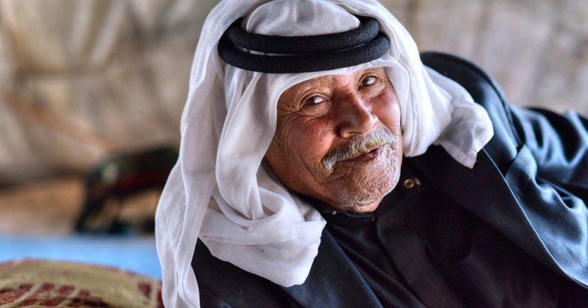 Portrait of the an old bedouin from Jordan in his traditional tent © akturer/Shutterstock