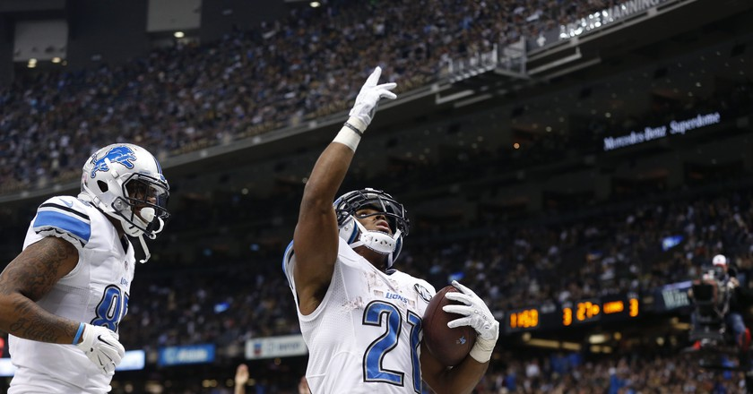 Ameer Abdullah (21) celebrates a TD against the New Orleans Saints | © Brynn Anderson/AP/REX/Shutterstock