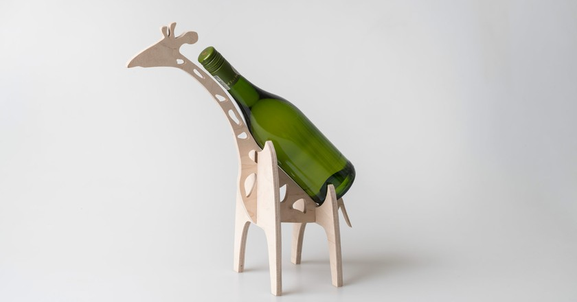 Native Décor creates homeware items with an African feel, like this giraffe wine bottle holder |Courtesy of Native Décor